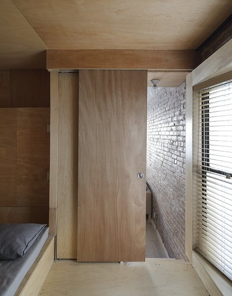 Doors, Sliding Door Type, and Interior The bedroom/office is a few steps above the living/dining room.  New York, New York Dwell Magazine : November / December 2017  Photo 7 of 10 in 10 Modern Barn Door Ideas You Wouldn't Expect