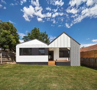 A New Hip Roof Rejuvenates a California-Style Bungalow in Melbourne - Photo 2 of 12 - The 2,691-square-foot home was given an entire new roof and facade at the rear.
