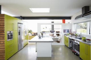 Equipped with Bosch appliances and a 16-foot steel countertop, the kitchen was tailor-made by architect and resident Nick Evans for his wife, Celia Sellschop, a chef.