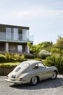 Nick's passion for midcentury design extends to cars. His 1959 Porsche 356A coupe is parked in the driveway.