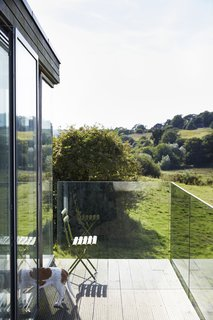 For uninterrupted views, the balcony is wrapped in glass panels.