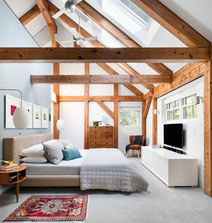 A 1974 Kit House Is Gutted in a Frenzy, Then Fine-Tuned For Close to a Decade - Photo 2 of 10 - Once covered in dark pine, a New York home is now radiant in Paper White by Benjamin Moore. The bed, flanked by George Nelson sconces, is from Crate and Barrel.