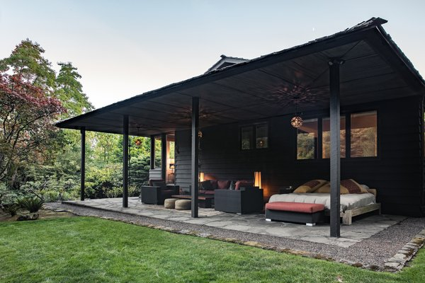 Outdoor, Trees, and Hardscapes The portico is used as a living room in Spring and Summer.  Photo 12 of 15 in Nearly 80 Years Later, an Architect Rescues a Japanese-Inspired  Masterwork Designed by His Father