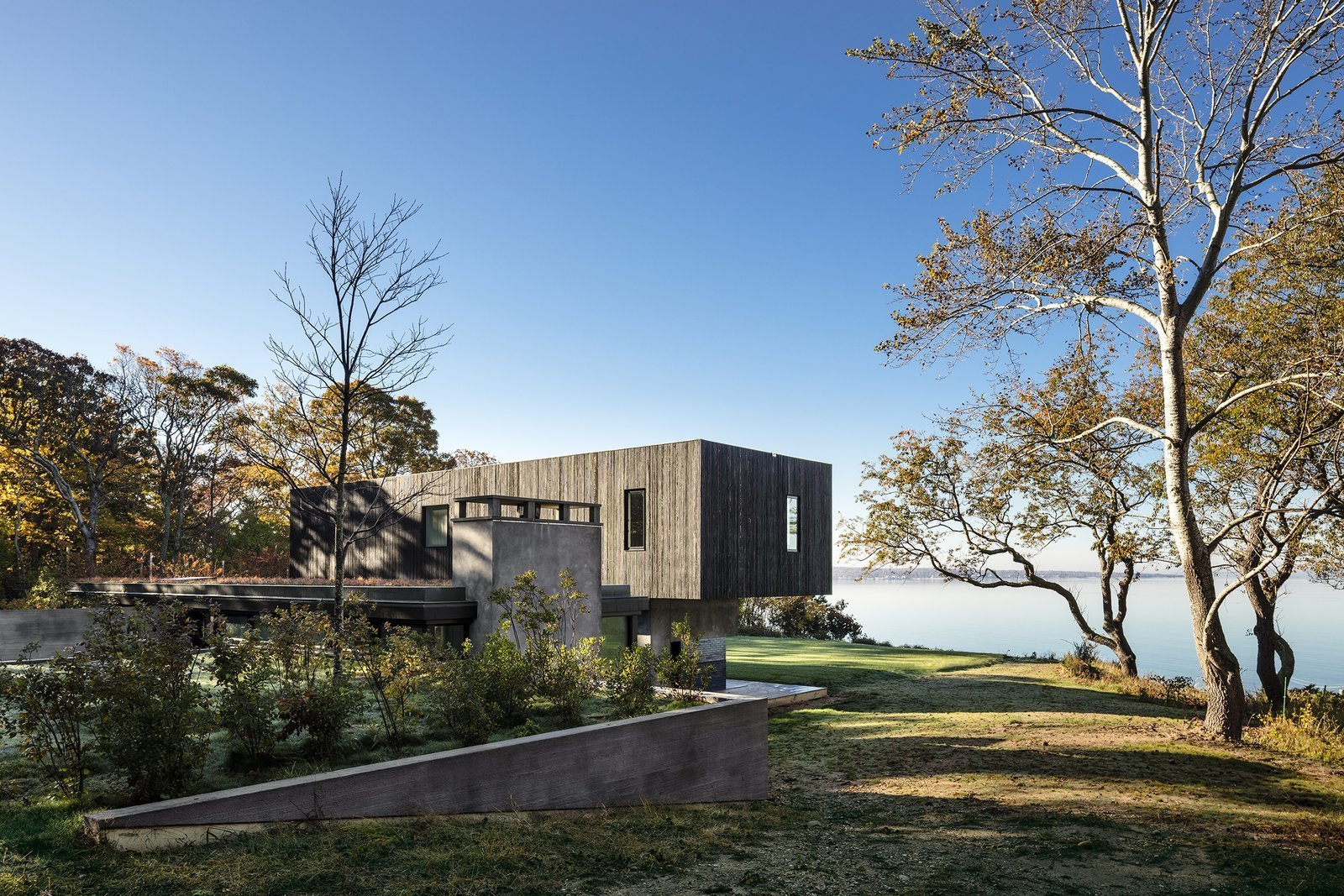 Exterior, House Building Type, Concrete Siding Material, Wood Siding Material, and Flat RoofLine  Photo 1 of 13 in An Incredible Cedar-Clad House Captures Views of the Sea and Forest