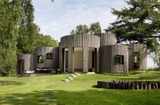Stay in This Danish Vacation Home Made Up of 9 Log-Clad Cylinders - Photo 1 of 14 -