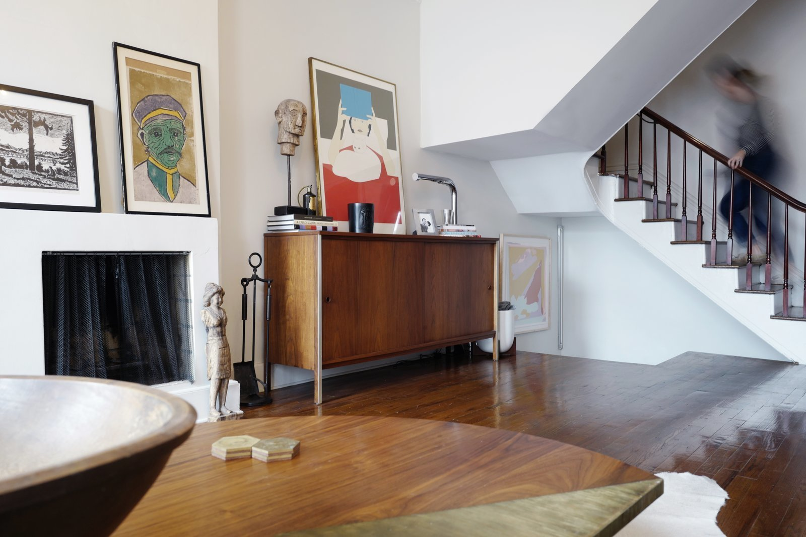 Living Room, Standard Layout Fireplace, Wood Burning Fireplace, Table Lighting, Coffee Tables, Media Cabinet, Dark Hardwood Floor, and Storage  Photo 1 of 16 in A Design Duo's 19th-Century Brooklyn Townhouse Is Filled With Art They Love