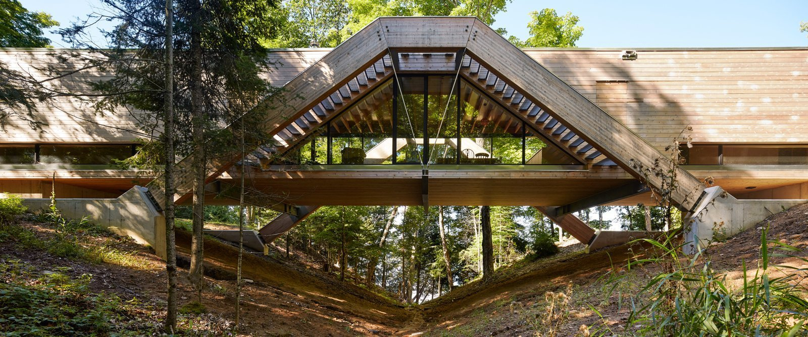 Exterior, House Building Type, Wood Siding Material, and Flat RoofLine  Photo 1 of 12 in A Unique Home in the Canadian Forest That Doubles As a Bridge
