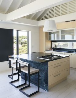 On the Coast of Massachusetts, a Prefab Ranch Is Totally Overhauled for a Wheelchair-User - Photo 9 of 11 - The counter stools are by Highline and the cooktop is by Bosch.