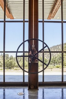 "A gearbox from an old irrigation pump helps turn the wheel that opens the window wall, a detail that reflects Kundig's love of simple yet sophisticated ""contraptions."""