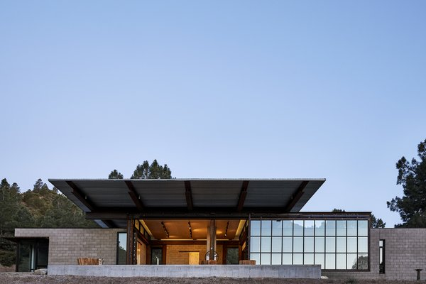 """For Bruce Shafer and Carol Horst's vacation home in the Tehachapi Mountains, architect Tom Kundig of Olson Kundig chose materials suited to the harsh climate. """"The area is super cold in winter and super hot in summer,"""" says Kundig, who designed a deep overhang to shade the core of the house from solar gain. """"In the high desert, it's not just about being in the sun, it's about getting out of the sun."""""""