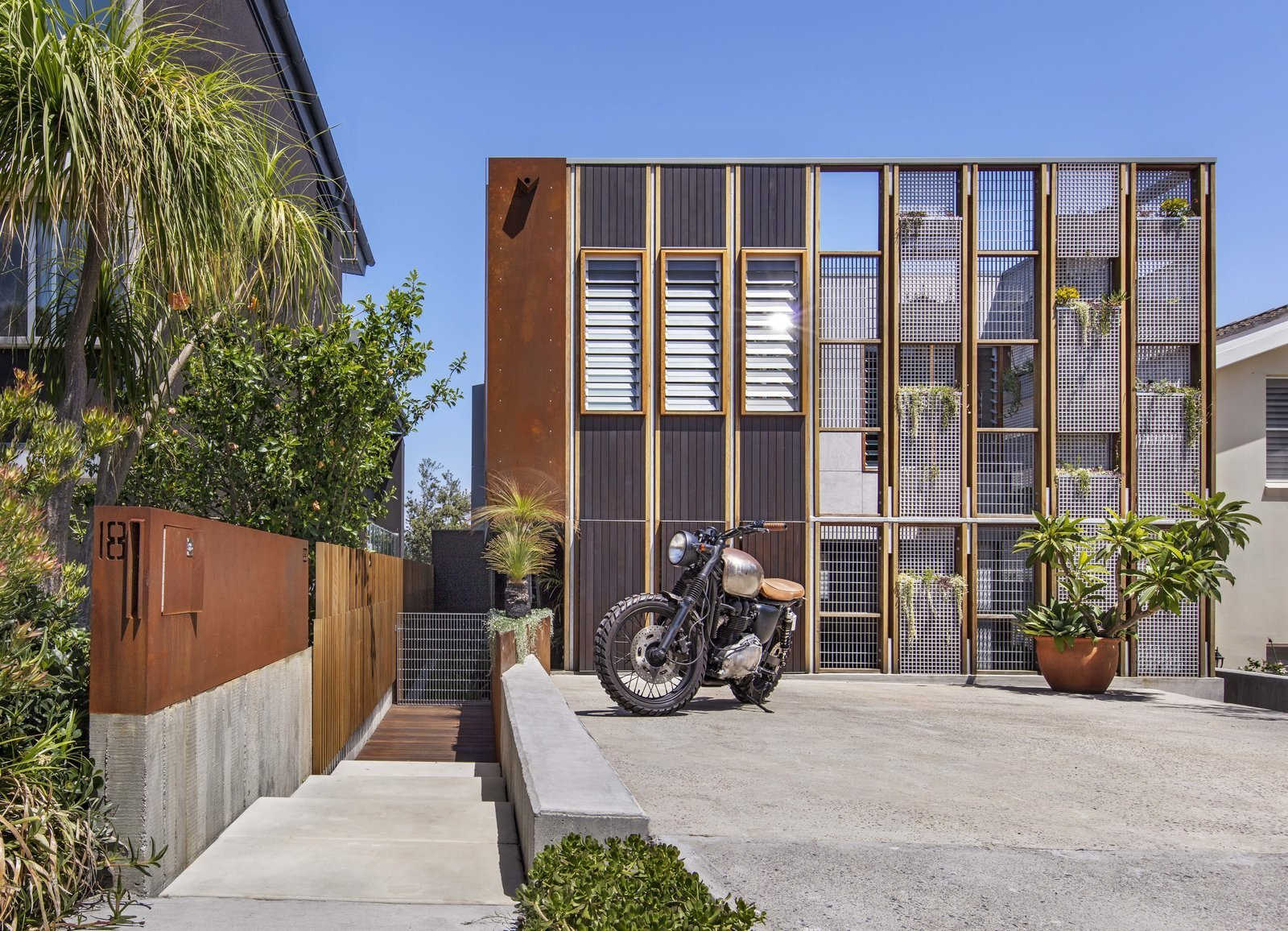 Exterior, Flat RoofLine, House Building Type, and Metal Siding Material  Best Photos from Living Screens Conceal a North Bondi Beach House and a Semi-Indoor Pool
