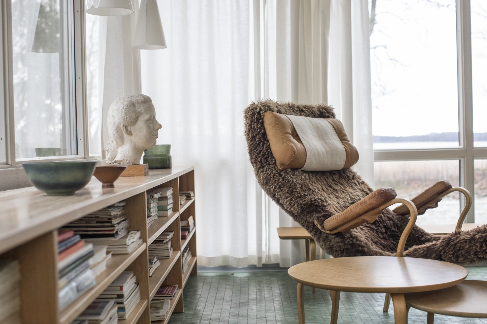 Living Room, Recliner, and Bookcase  Photo 5 of 15 in 72 Hours in Småland, Sweden—Part Two from Swedish Designer Bruno Mathsson's Home Is a Perfect Midcentury Time Capsule