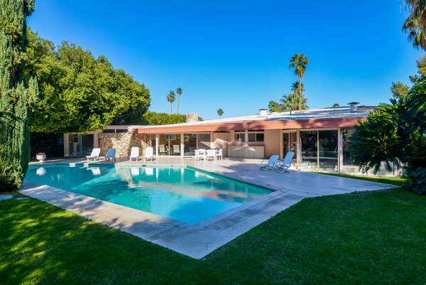 Outdoor, Back Yard, Concrete Patio, Porch, Deck, Large Pools, Tubs, Shower, Grass, Trees, and Walkways  Photo 8 of 8 in Elvis Presley's Palm Springs Honeymoon Retreat Hits the Market