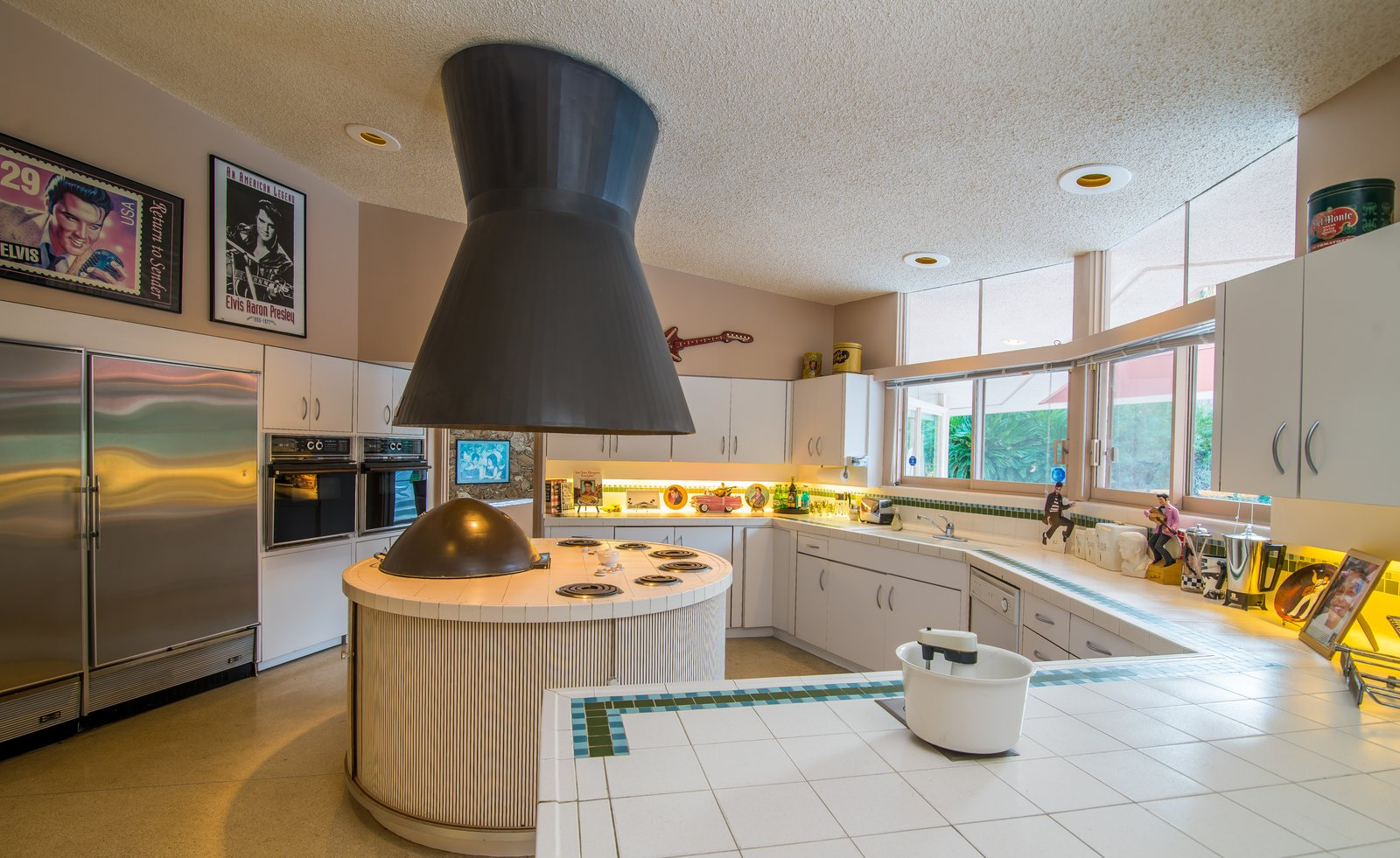 Kitchen, Refrigerator, Range Hood, Tile Counter, and White Cabinet  Photo 5 of 8 in Elvis Presley's Palm Springs Honeymoon Retreat Hits the Market
