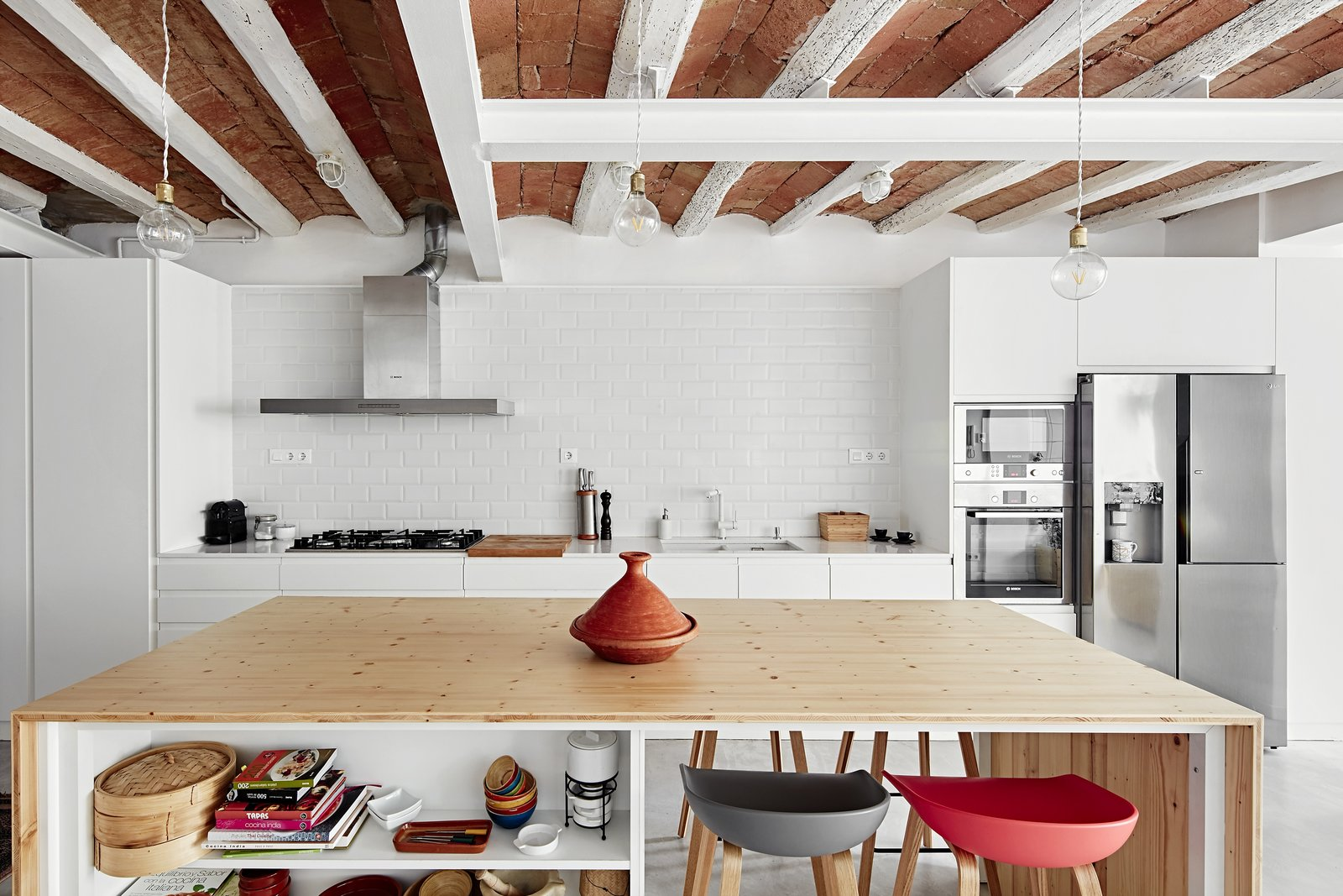 Kitchen, Microwave, Refrigerator, Wall Oven, Undermount, Range, Range Hood, White, Concrete, and Pendant  Best Kitchen Refrigerator Range Hood Undermount Pendant Concrete Photos from Can This Renovated, Loft-Like Home in Spain Be Any Dreamier?