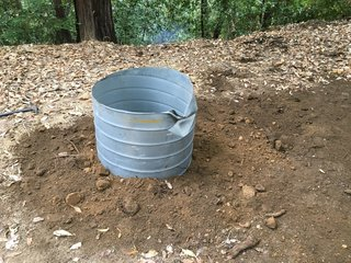 After cleaning up the hole, you can shore the top of it with an old piece of 32-inch diameter galvanized culvert that you can pick up at your local rebuilding center for cheap, and fill in around it.