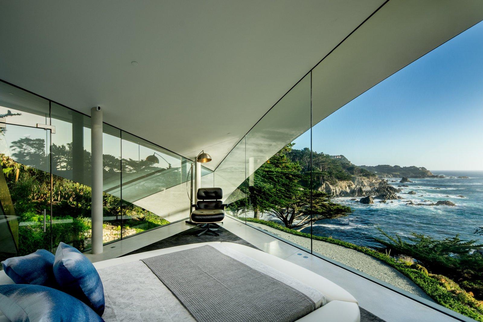 Bedroom, Bed, Concrete Floor, Chair, and Floor Lighting  Best Photos from Oceanfront Wonder in Carmel Asks $11.4M