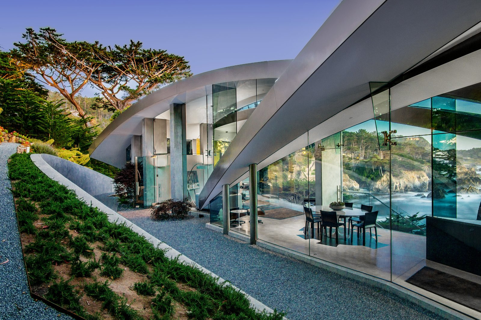 Exterior, Curved RoofLine, Metal Roof Material, Glass Siding Material, House Building Type, and Beach House Building Type  Oceanfront Wonder in Carmel Asks $11.4M