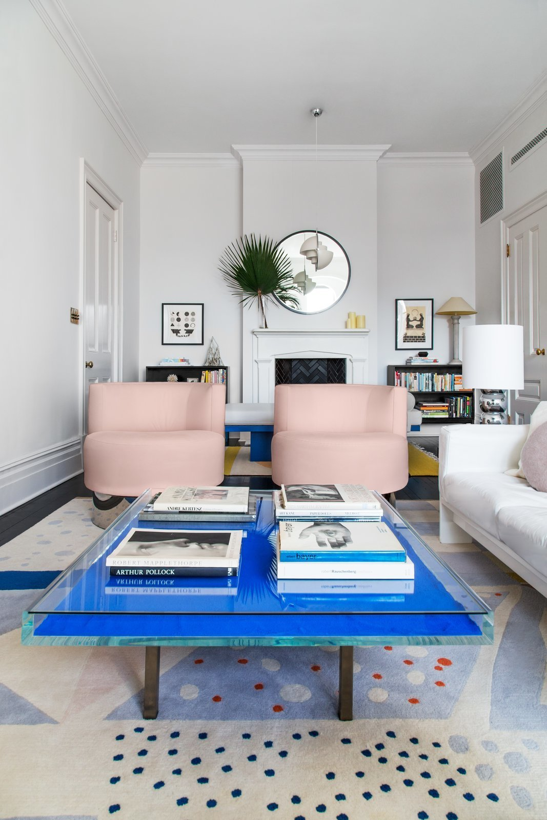 Living Room, Chair, Coffee Tables, Rug Floor, Standard Layout Fireplace, Table Lighting, and Pendant Lighting  Photo 3 of 22 in A 19th-Century Schoolhouse in Brooklyn Becomes a Classy Apartment