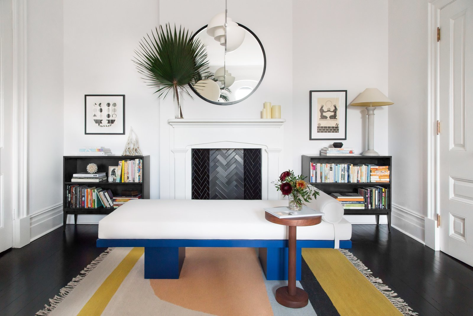Living Room, Pendant Lighting, Table Lighting, Rug Floor, and Bookcase  Photo 6 of 22 in A 19th-Century Schoolhouse in Brooklyn Becomes a Classy Apartment