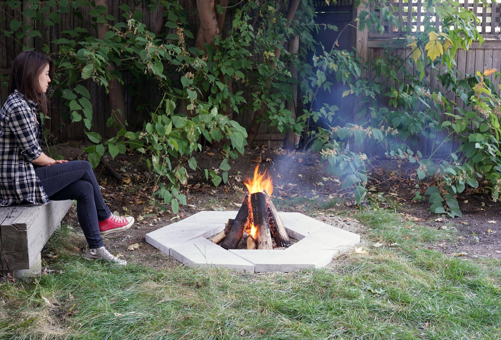 Outdoor, Back Yard, Hardscapes, and Grass  Photo 1 of 10 in Dwell Made Presents: DIY Stone Fire Pit