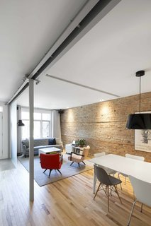 Blocked in on Two Sides, a Renovation Opens a Quebec Apartment to Tons of Natural Light