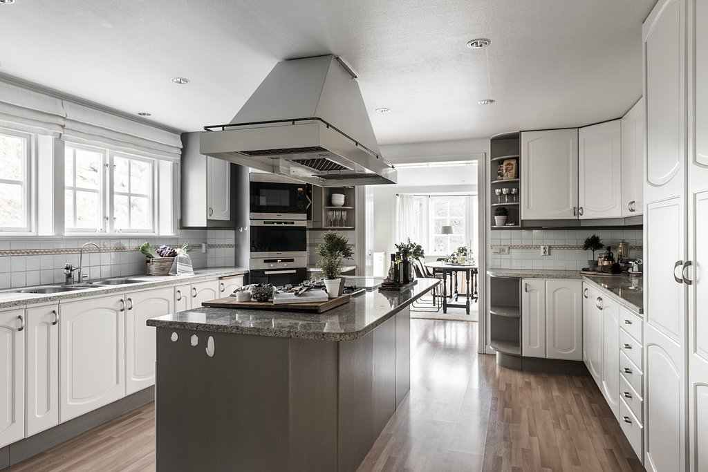 Kitchen, White, Range Hood, Wall Oven, Medium Hardwood, Drop In, Ceramic Tile, Recessed, Range, and Microwave  Best Kitchen Microwave Drop In Range Hood Recessed Photos from Kitchens