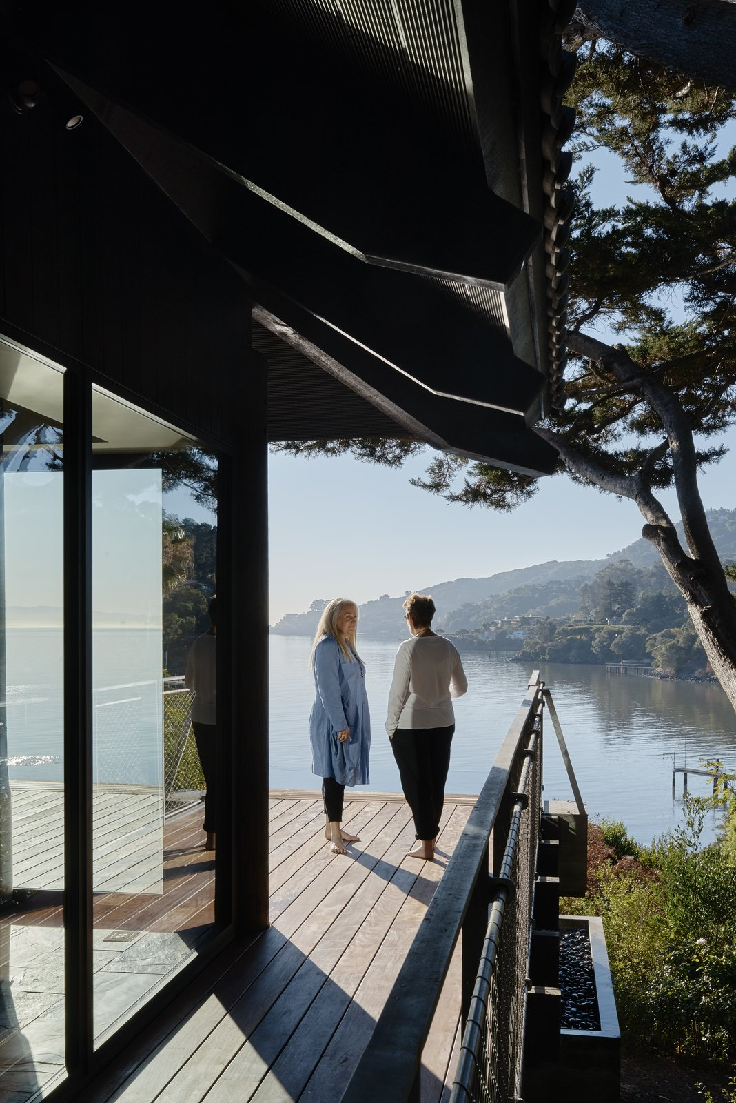 Outdoor, Wood Patio, Porch, Deck, Trees, Large Patio, Porch, Deck, Side Yard, and Shrubs  Photo 12 of 13 in You'd Never Guess This Japanese-Style Home in Tiburon Is a Kit House