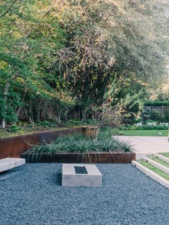 Landscape architect David Hocker defined the sunken fire pit area with Cor-Ten steel.