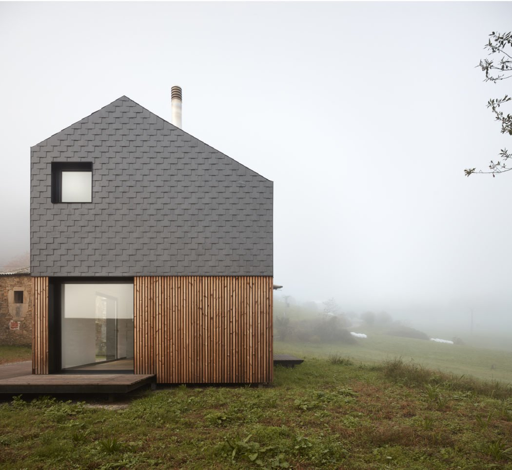 Exterior, House Building Type, Glass Siding Material, Saltbox RoofLine, Prefab Building Type, and Wood Siding Material  Photos from This Affordable Prefab in Spain Only Took 5 Hours to Assemble
