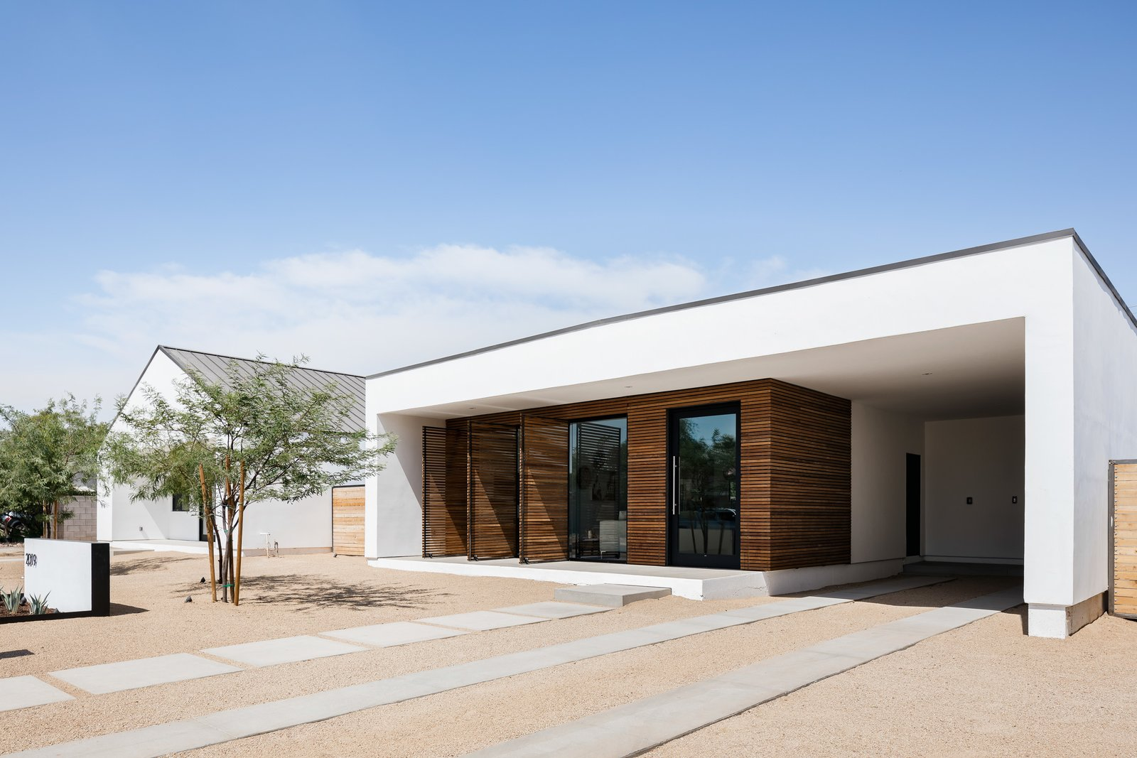 Exterior, Stucco Siding Material, Wood Siding Material, Flat RoofLine, and House Building Type  Photo 1 of 13 in In Arizona, a Modern Cube and Tumbledown 1930s Shack Make an Unlikely Couple