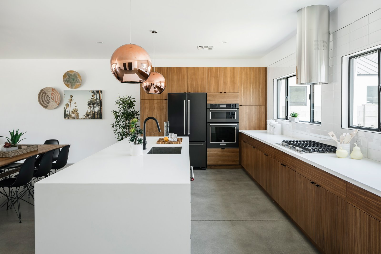 Kitchen, Undermount Sink, Wood Cabinet, Engineered Quartz Counter, Range, Range Hood, Concrete Floor, and Pendant Lighting  Photo 3 of 13 in In Arizona, a Modern Cube and Tumbledown 1930s Shack Make an Unlikely Couple