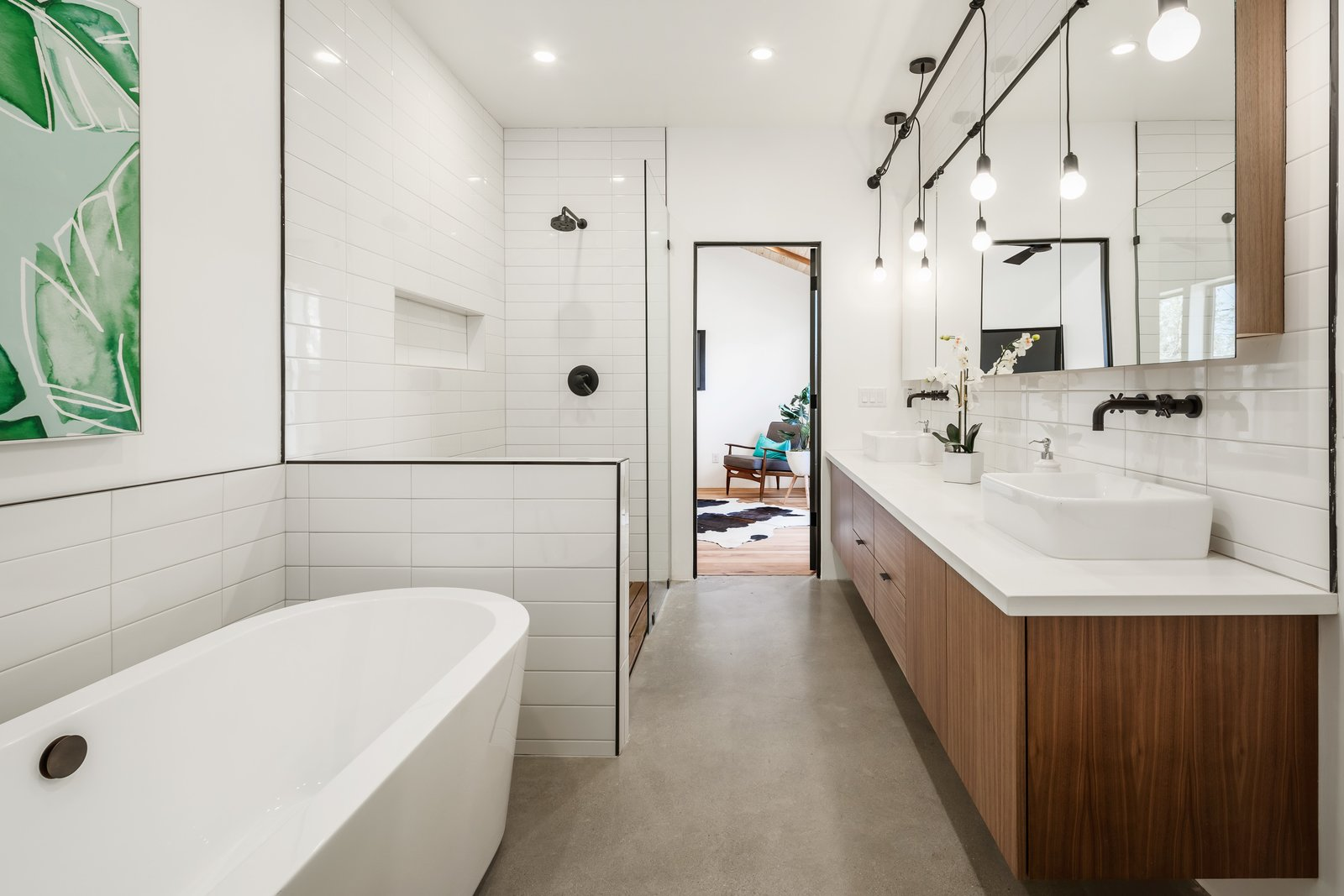 Bath Room, Subway Tile Wall, Enclosed Shower, Engineered Quartz Counter, Vessel Sink, Pendant Lighting, Concrete Floor, Freestanding Tub, Ceiling Lighting, and Recessed Lighting  Photo 9 of 13 in In Arizona, a Modern Cube and Tumbledown 1930s Shack Make an Unlikely Couple