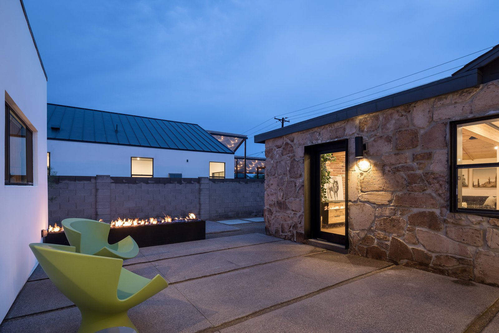 Outdoor, Concrete Patio, Porch, Deck, Back Yard, and Landscape Lighting  Photo 12 of 13 in In Arizona, a Modern Cube and Tumbledown 1930s Shack Make an Unlikely Couple