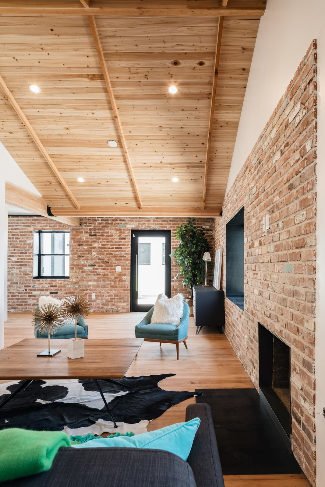 Living Room, Coffee Tables, Recessed Lighting, Standard Layout Fireplace, Ceiling Lighting, Sofa, Chair, and Medium Hardwood Floor  Photo 11 of 13 in In Arizona, a Modern Cube and Tumbledown 1930s Shack Make an Unlikely Couple