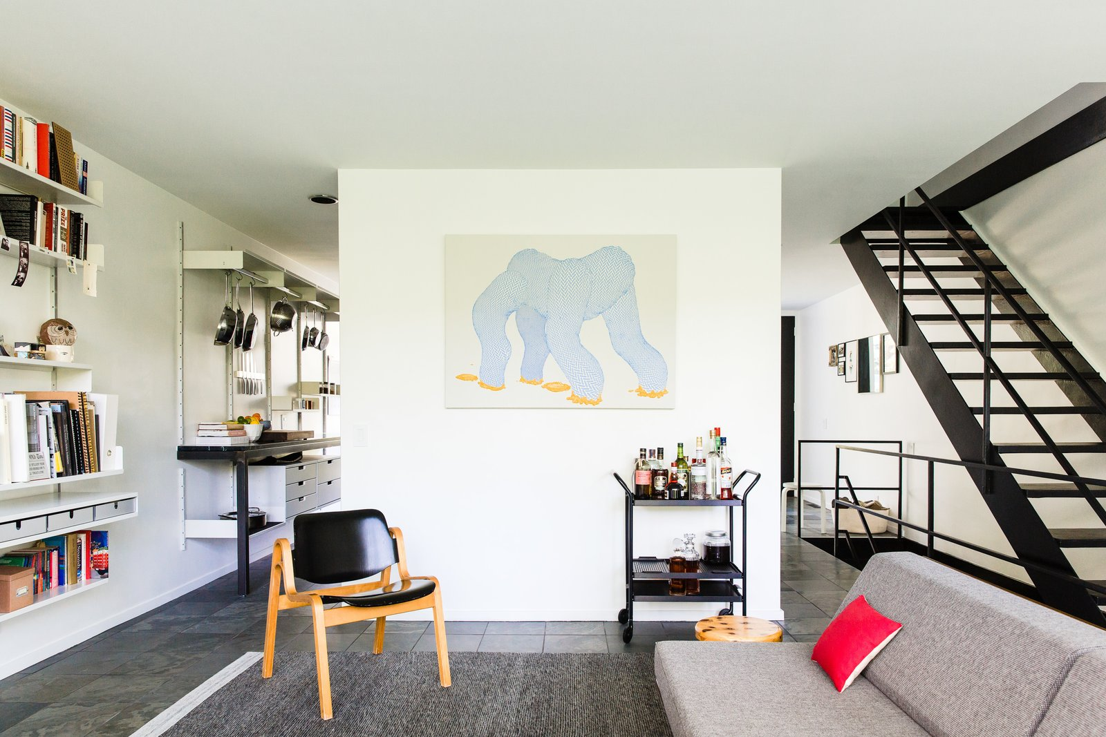 Living, Recessed, Shelves, Storage, Slate, Chair, Bar, Rug, Sofa, and Stools  Living Bar Slate Photos from A New York Transplant Remakes One of Mies van der Rohe's Coveted Townhouses in Detroit