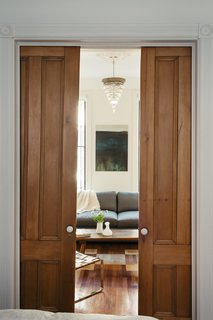 Self-taught designer Tom Givone fixed up his 1882 row house in New York City over many years. In the parlor, he uncovered pocket doors entombed in sheetrock.