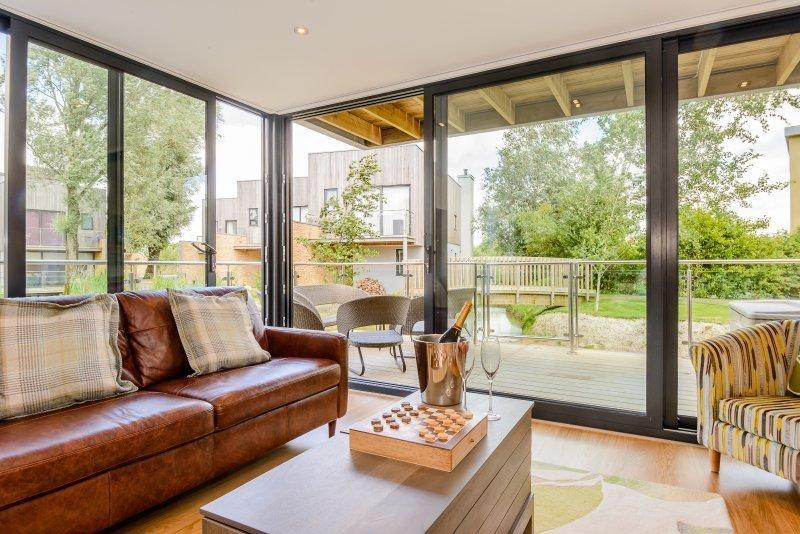 Living Room, Ceiling Lighting, Medium Hardwood Floor, Recessed Lighting, Coffee Tables, Chair, and Sofa  No. 1 The Water Gardens