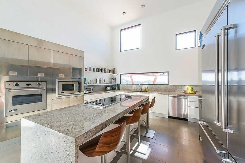 Kitchen, Recessed Lighting, Refrigerator, Wall Oven, Cooktops, and Metal Cabinet  Architectural Dream Villa