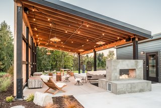 Serenity Awaits at These Prefab Cabin Rentals on Vashon Island - Photo 4 of 6 - The Pavilion has plenty of cozy seating, a cast concrete fireplace, and a sound system.