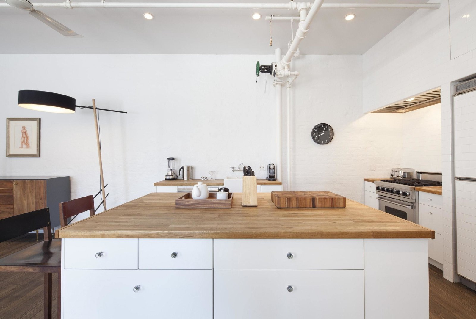 Kitchen, Range, White Cabinet, Medium Hardwood Floor, Vessel Sink, Wood Counter, Wall Oven, Recessed Lighting, and Refrigerator  Prince Street