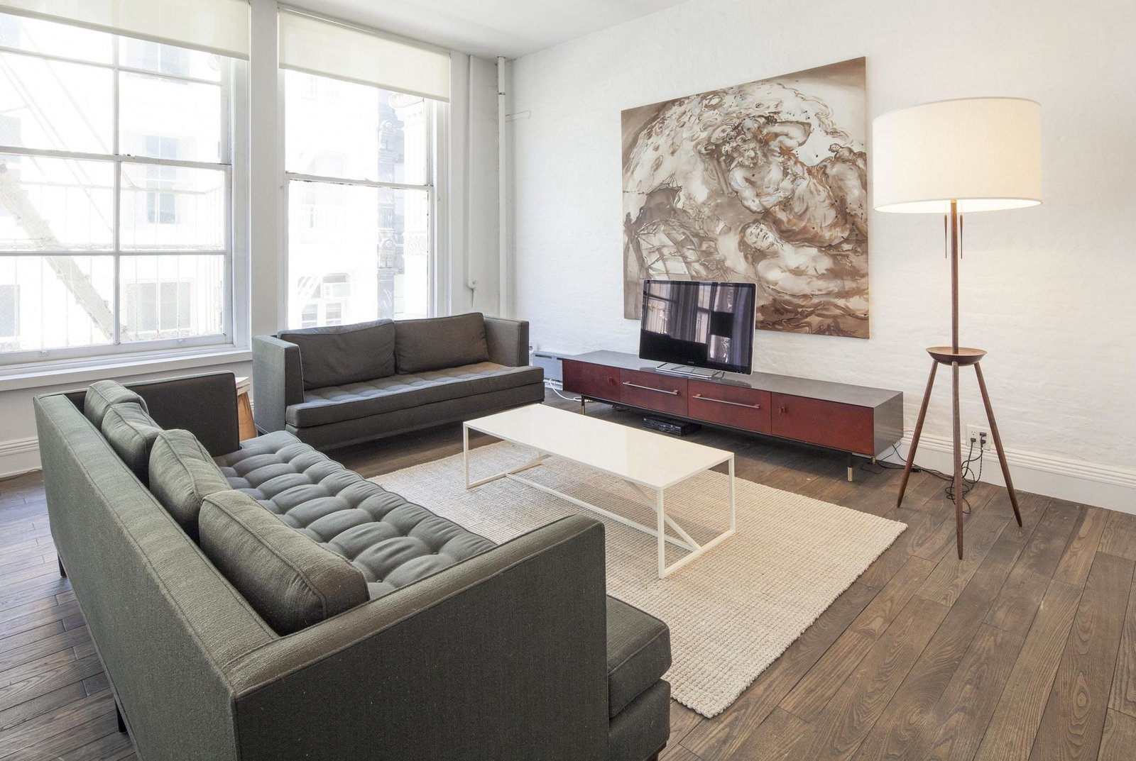 Living Room, End Tables, Sofa, Rug Floor, Medium Hardwood Floor, Coffee Tables, Floor Lighting, and Media Cabinet  Prince Street