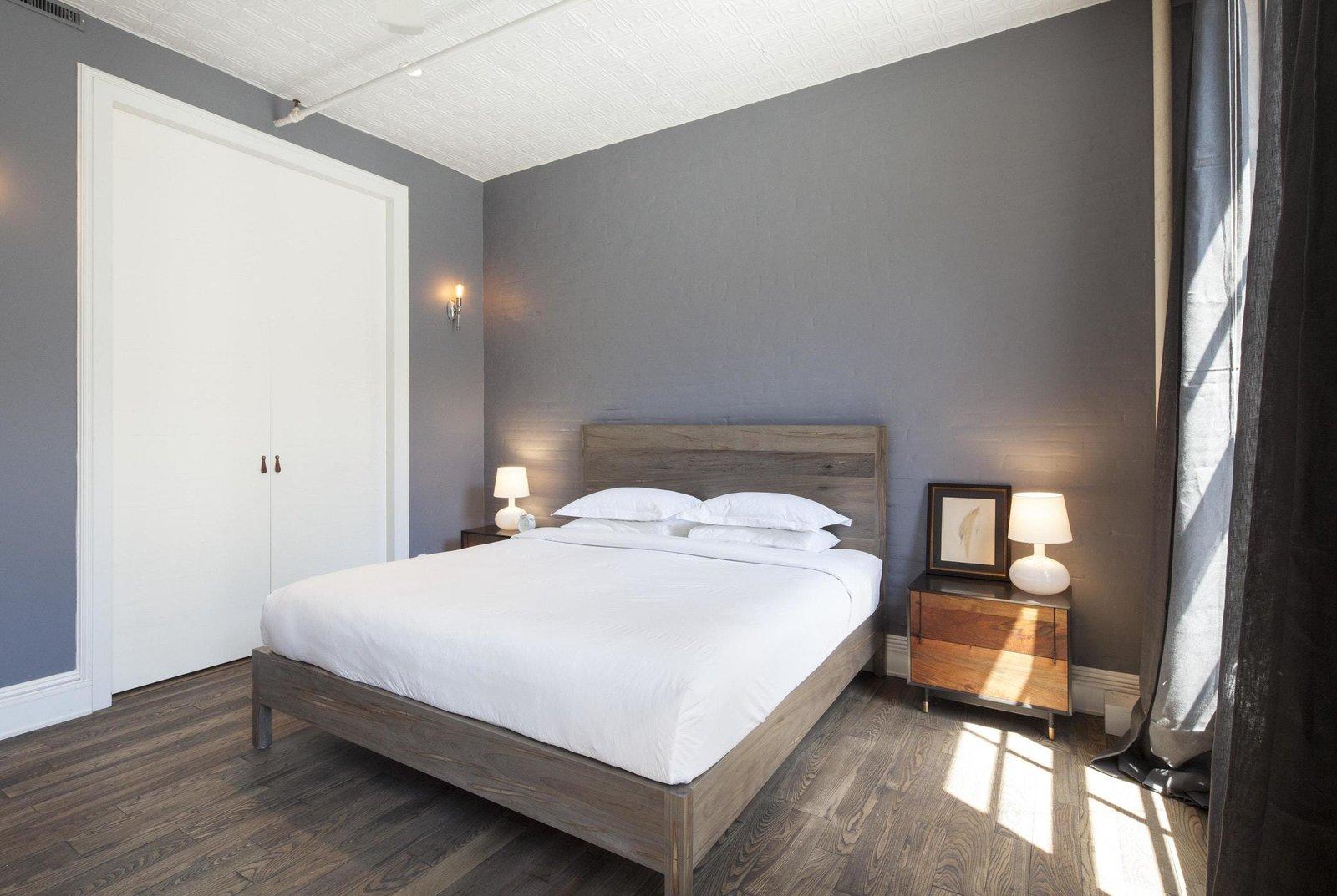 Bedroom, Night Stands, Wall Lighting, Bed, Table Lighting, Medium Hardwood Floor, and Storage  Prince Street