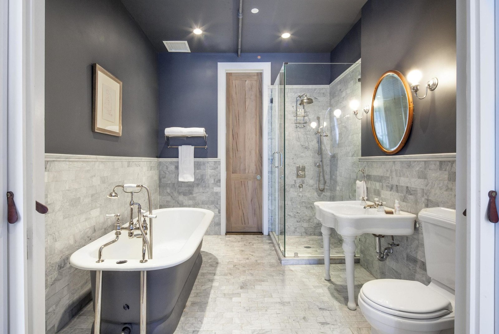 Bath Room, Recessed Lighting, Two Piece Toilet, Freestanding Tub, Pedestal Sink, Wall Mount Sink, Marble Wall, Enclosed Shower, Corner Shower, and Marble Floor  Prince Street