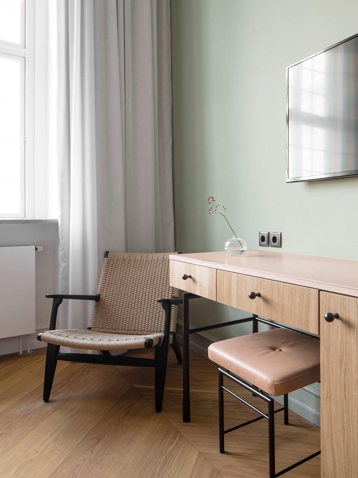Bedroom, Chair, and Medium Hardwood Floor  Nobis Hotel Copenhagen