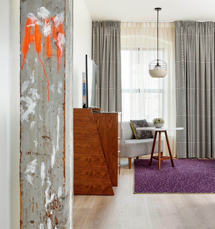 Living Room, Coffee Tables, Sofa, Light Hardwood Floor, Rug Floor, Pendant Lighting, and Media Cabinet  21c Museum Hotel Nashville