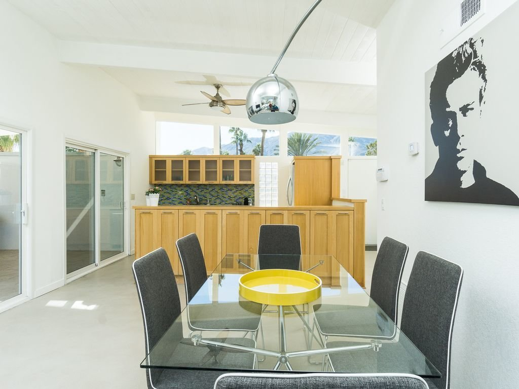 Dining Room, Table, Floor Lighting, and Chair  Racquet Club North House With a Citrus-Colored Door