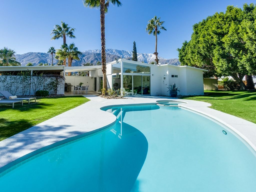 Outdoor, Trees, Grass, Swimming Pools, Tubs, Shower, and Back Yard  Racquet Club North House With a Citrus-Colored Door