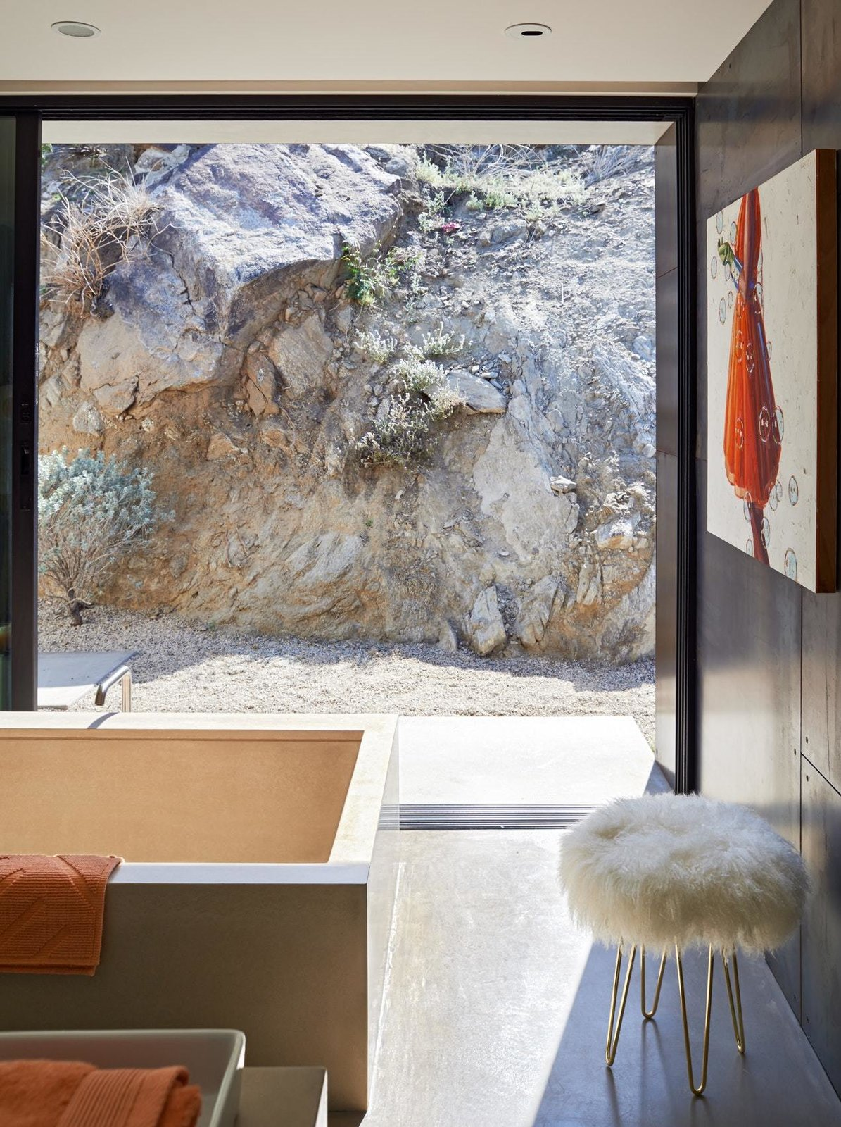 Bath Room, Concrete Floor, Metal Wall, Drop In Sink, Recessed Lighting, Freestanding Tub, and Undermount Tub  On the Rocks