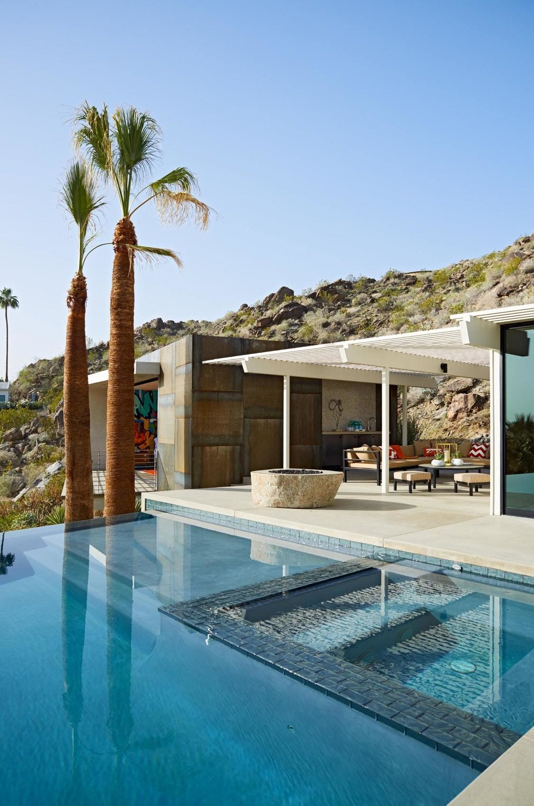 Outdoor, Concrete Patio, Porch, Deck, Trees, Salt Water Pools, Tubs, Shower, Infinity Pools, Tubs, Shower, Back Yard, Desert, and Swimming Pools, Tubs, Shower  On the Rocks